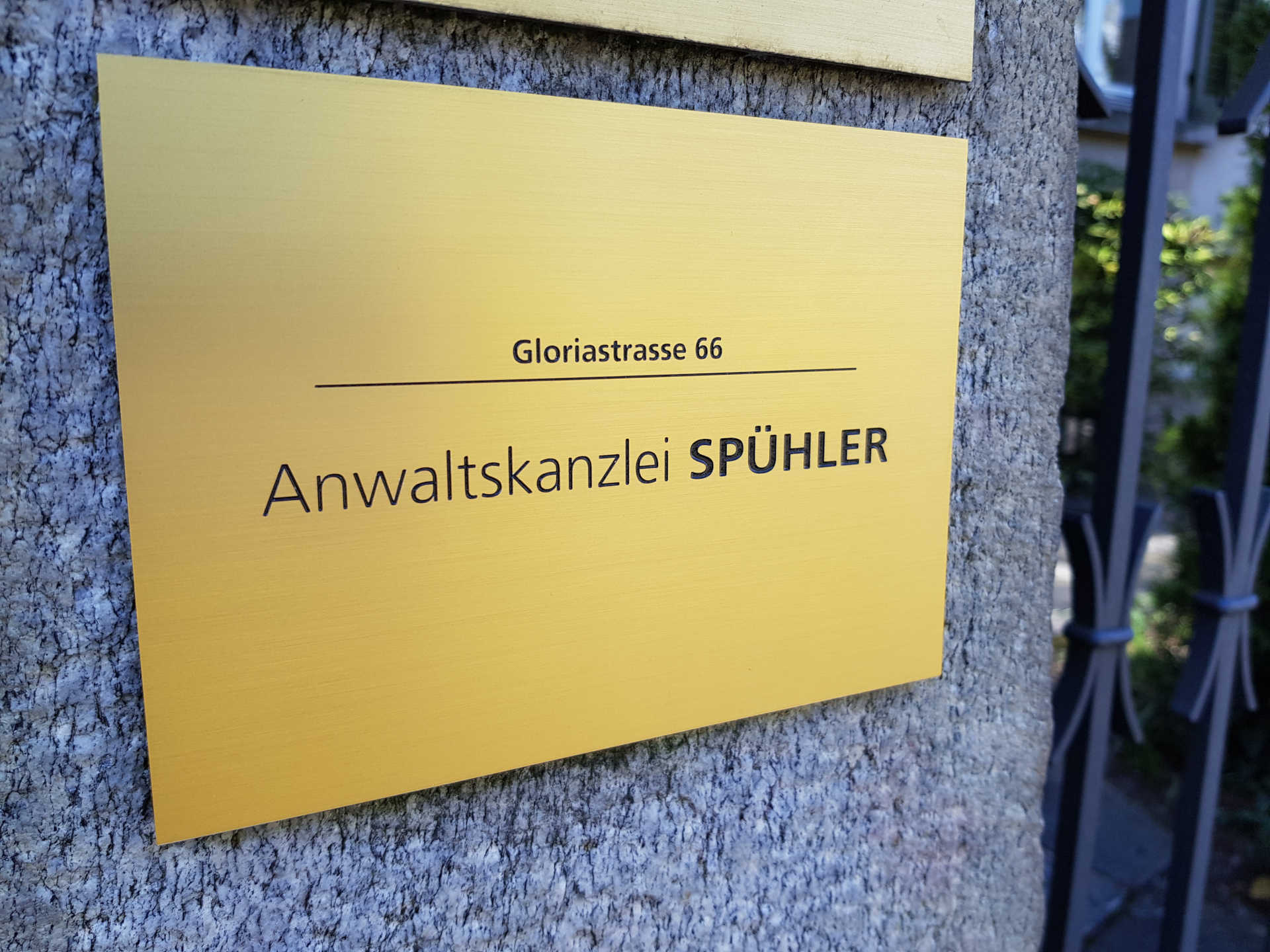 Company sign of the law firm Spühler